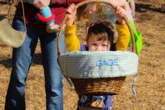 boy holding up basket
